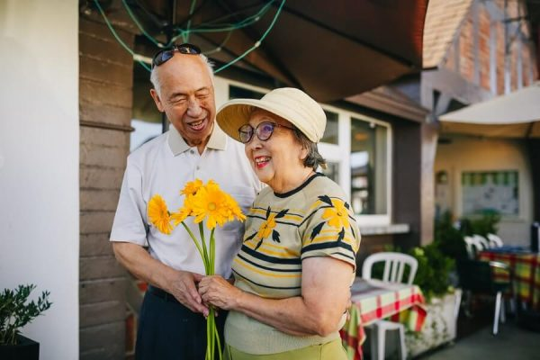 elderly couple with yellow flowers